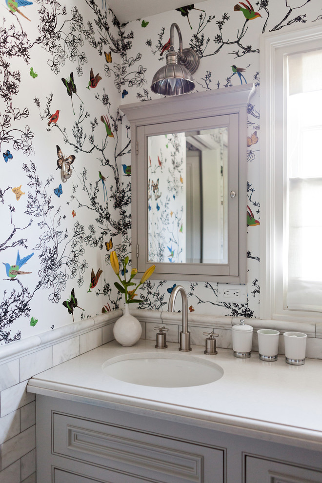 Inspiration for a transitional bathroom remodel in Los Angeles with multicolored walls and beaded inset cabinets
