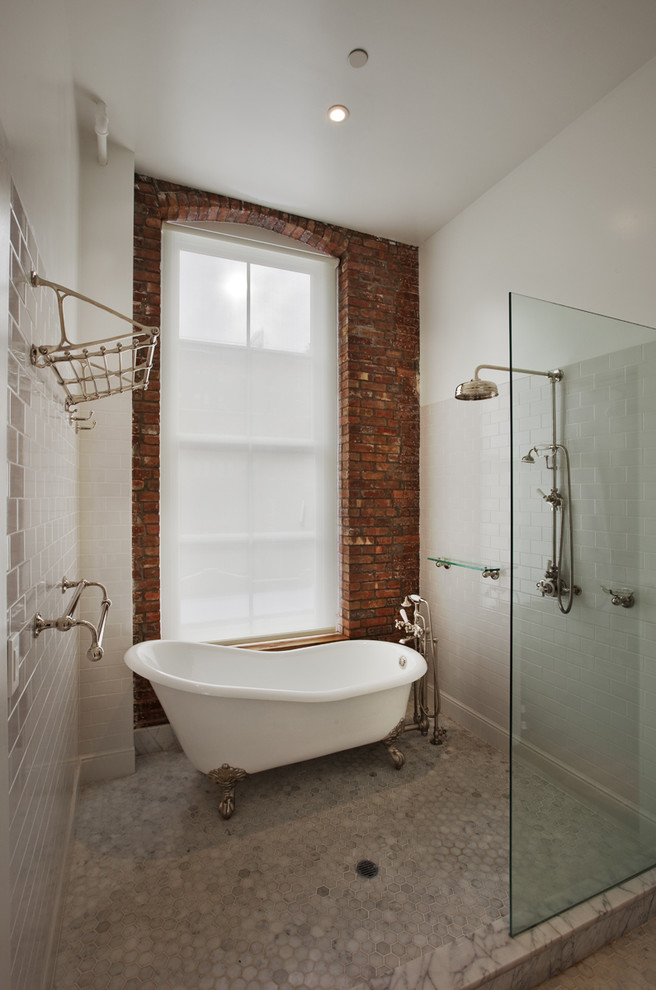 Inspiration for a mid-sized industrial 3/4 white tile and subway tile marble floor and gray floor bathroom remodel in New York with white walls