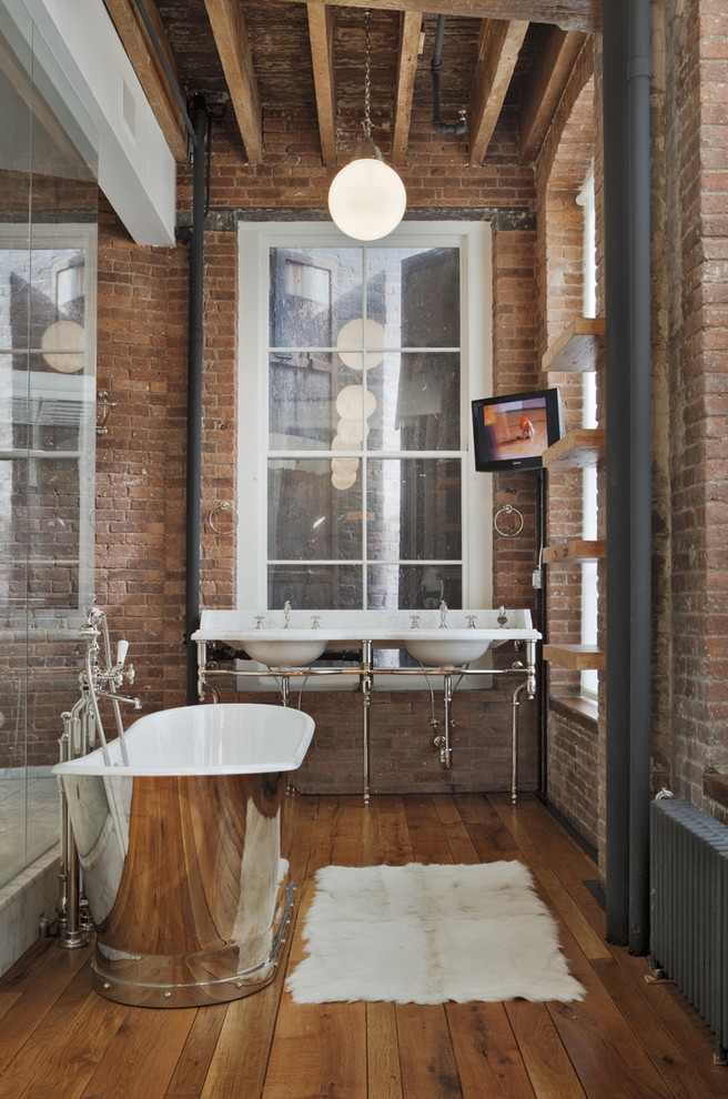 Bathroom - large industrial master red tile medium tone wood floor bathroom idea in New York with red walls, a console sink, marble countertops, open cabinets and medium tone wood cabinets