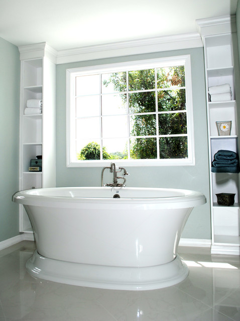 Free Standing Tub Framed By Built In Shelves Traditional Bathroom Tampa