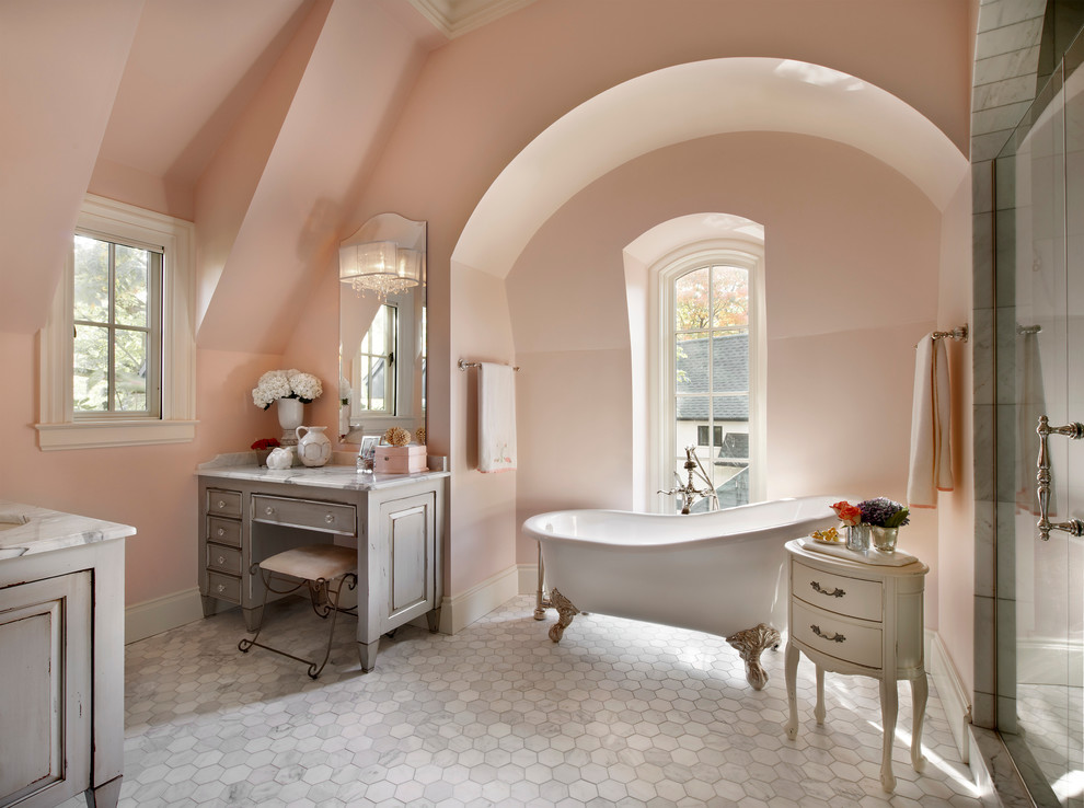 Elegant bathroom photo in Chicago with marble countertops and pink walls