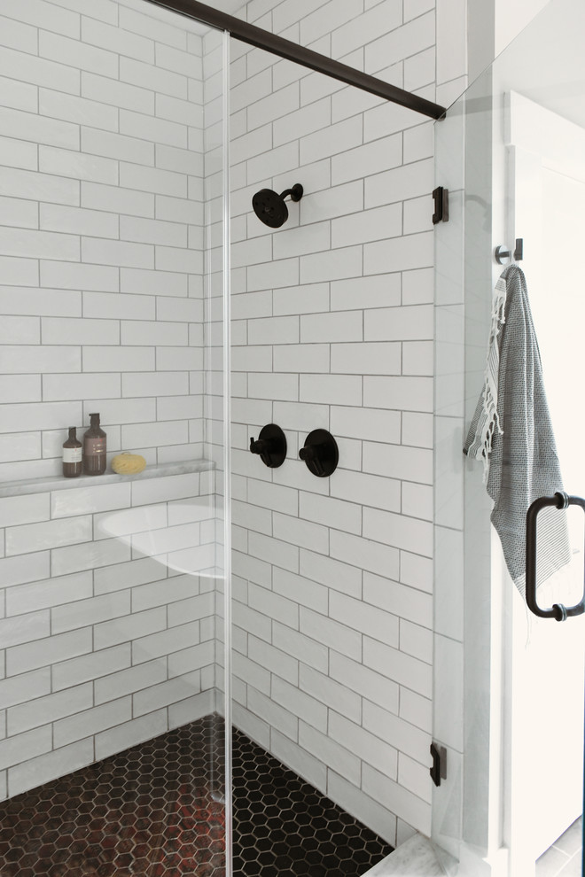 Bathroom - small contemporary master white tile and subway tile porcelain tile and black floor bathroom idea in Other with shaker cabinets, light wood cabinets, an undermount sink, quartzite countertops, a hinged shower door and white countertops