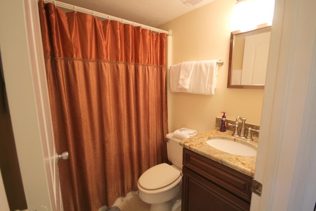 Ft myers beach sunset condo tropical bathroom by for Sunset bathroom designs