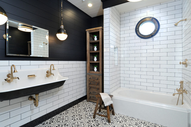 Inspiration for a classic bathroom in Los Angeles with a shower/bath combination, black and white tiles, metro tiles, black walls, a trough sink and a built-in bath.