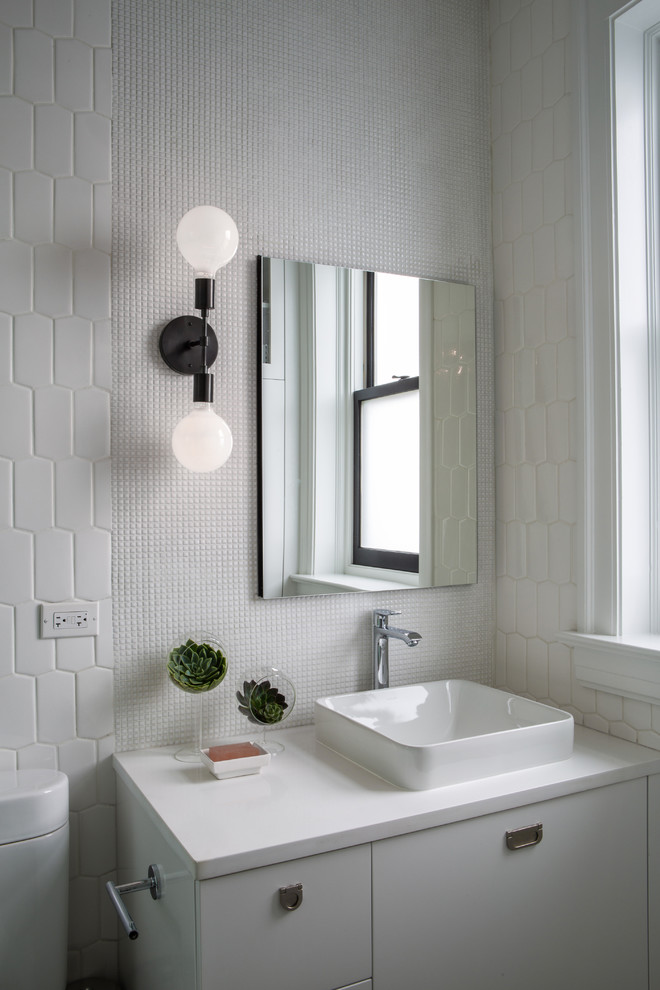 Inspiration for a mid-century modern bathroom remodel in Chicago with flat-panel cabinets, white cabinets, white walls and a vessel sink
