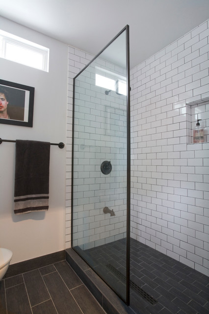 Garage conversion in studio city industrial bathroom - White subway tile with black grout bathroom ...