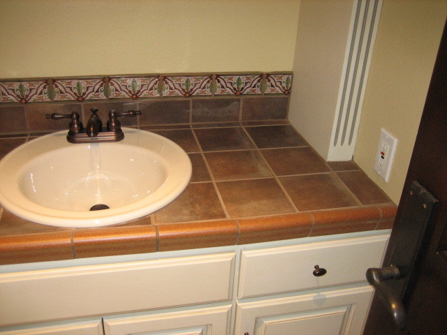 Garret home remodel with spanish ceramic tile for Tile countertops bathroom ideas
