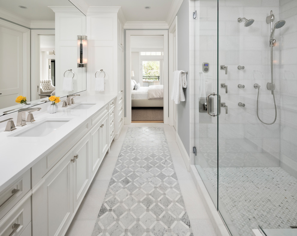 Double shower - mid-sized transitional master marble floor and white floor double shower idea in Minneapolis with white cabinets, gray walls, quartz countertops, a hinged shower door, recessed-panel cabinets, an undermount sink and white countertops