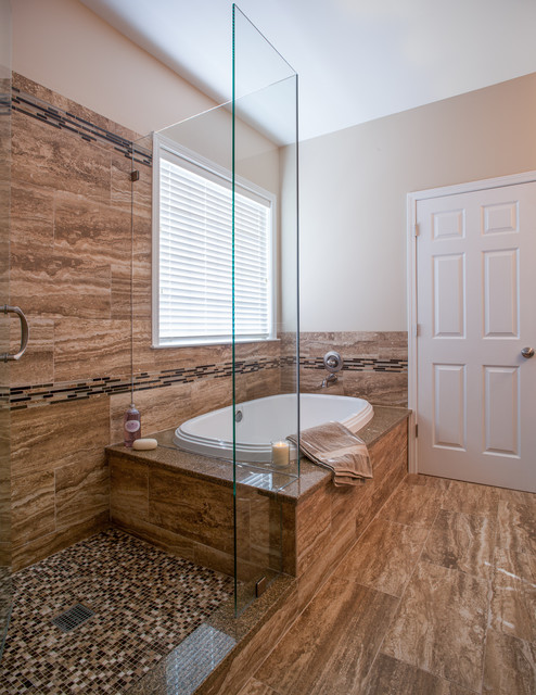 Example of a small trendy master brown tile and porcelain tile porcelain floor bathroom design in Charlotte with an undermount sink, flat-panel cabinets, dark wood cabinets, granite countertops and beige walls