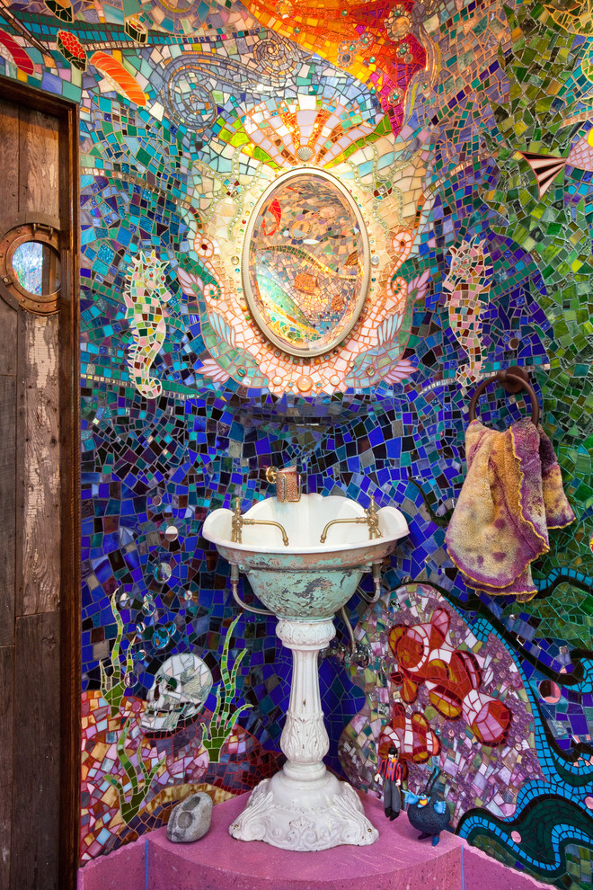 Inspiration for an eclectic multicolored tile and mosaic tile pink floor bathroom remodel in San Francisco with a pedestal sink