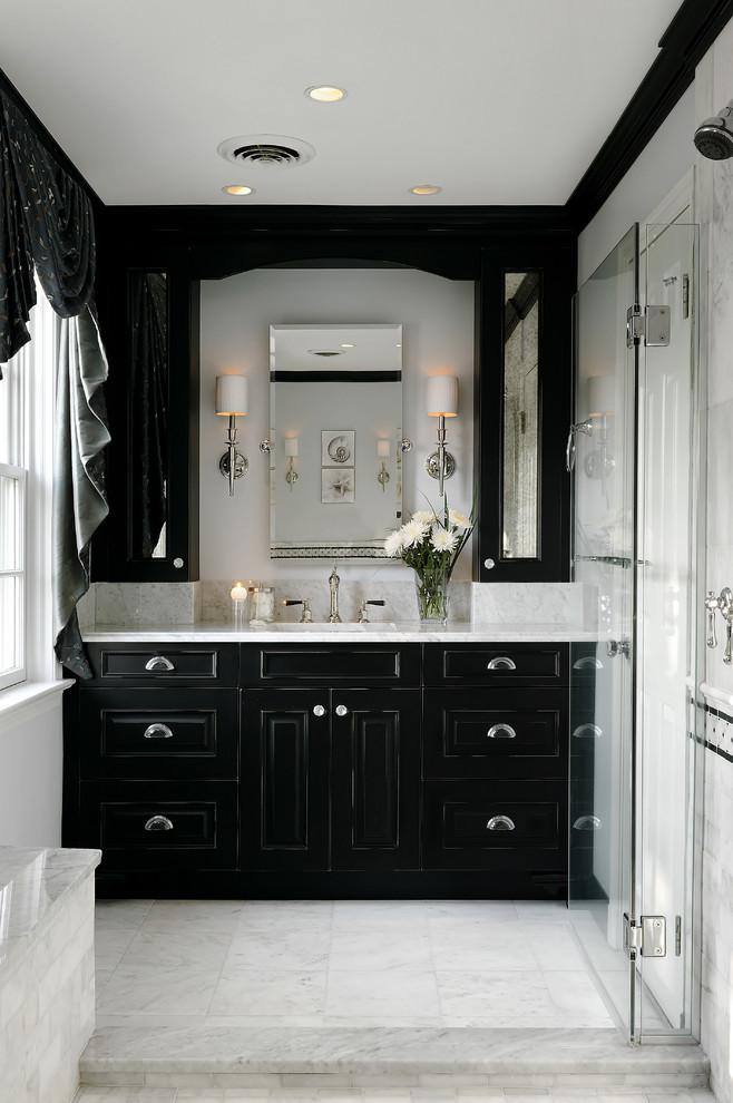 Bathroom - traditional marble floor bathroom idea in DC Metro with black cabinets