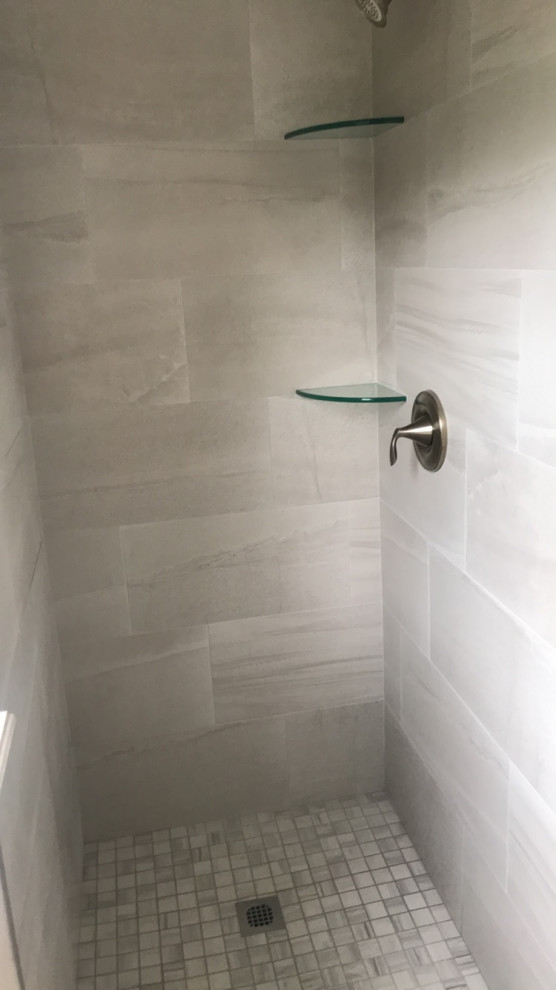 Mid-sized minimalist master beige tile and porcelain tile porcelain floor and gray floor bathroom photo in Jacksonville with shaker cabinets, beige cabinets, white walls, an undermount sink, quartzite countertops and gray countertops