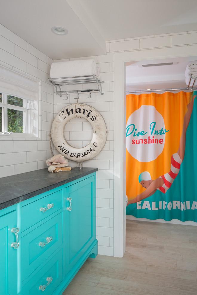 Inspiration for a beach style white tile and subway tile bathroom remodel in Los Angeles with recessed-panel cabinets, blue cabinets and soapstone countertops