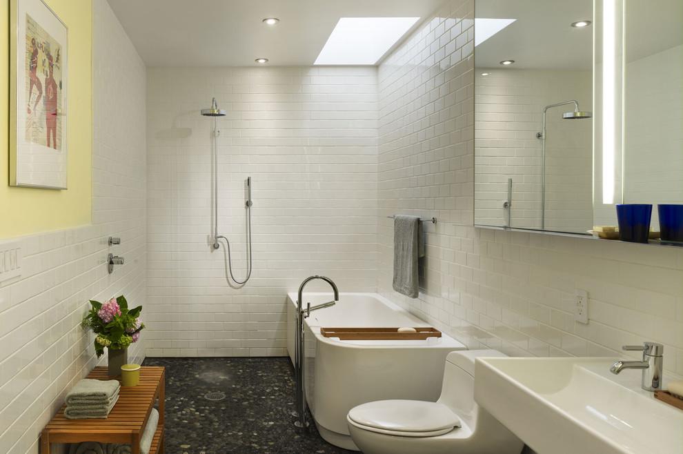 Inspiration for a modern subway tile pebble tile floor bathroom remodel in Philadelphia