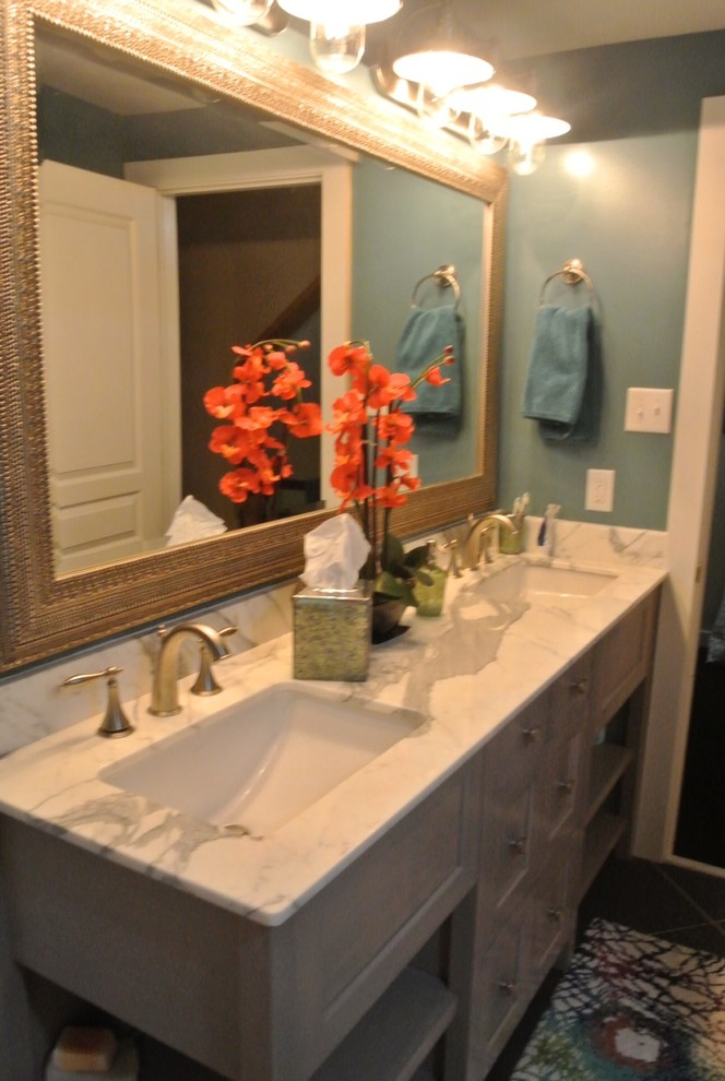 Example of a mid-sized classic kids' gray tile and porcelain tile porcelain tile bathroom design in Other with an undermount sink, furniture-like cabinets, light wood cabinets, marble countertops, a one-piece toilet and blue walls