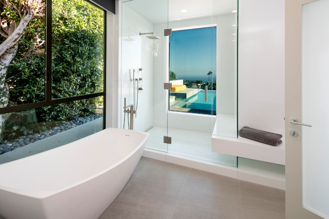 Example of a mid-sized trendy master white tile and stone slab porcelain floor and gray floor bathroom design in Los Angeles with white walls and a hinged shower door