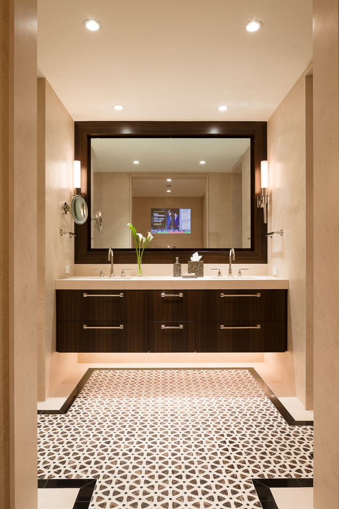 Example of a trendy bathroom design in Chicago with an undermount sink, flat-panel cabinets and dark wood cabinets