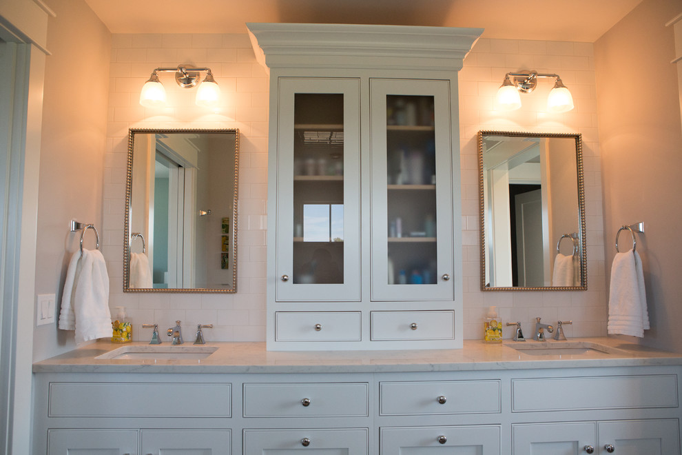 Inspiration for a large transitional master white tile and ceramic tile porcelain tile and gray floor double shower remodel in Other with shaker cabinets, white cabinets, a two-piece toilet, white walls, an undermount sink, quartz countertops and a hinged shower door
