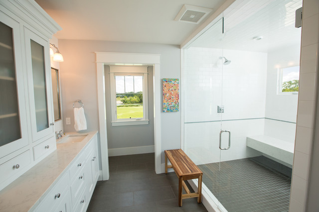Double shower - large transitional master white tile and ceramic tile porcelain floor and gray floor double shower idea in Other with shaker cabinets, white cabinets, a two-piece toilet, white walls, an undermount sink, engineered quartz countertops and a hinged shower door