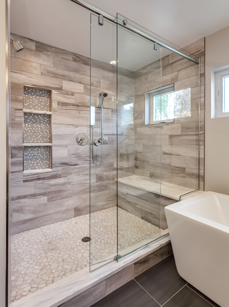 Huge trendy master beige tile and ceramic tile bathroom photo in Denver with flat-panel cabinets, gray walls, an undermount sink and granite countertops