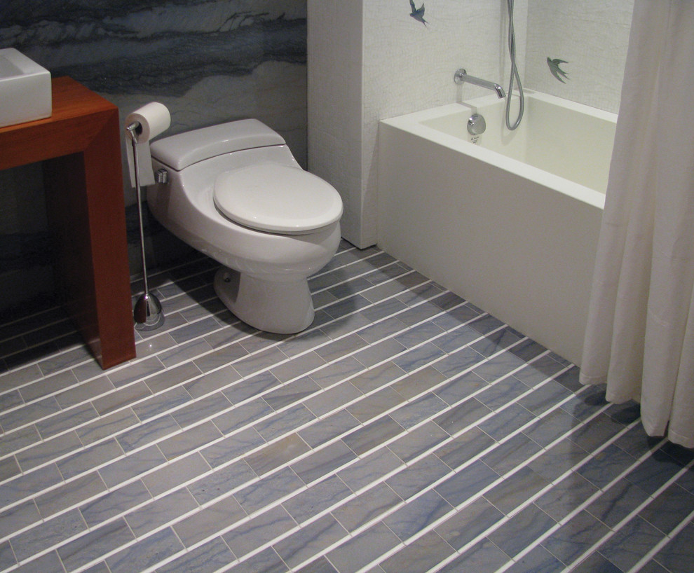 Trendy multicolored tile marble floor bathroom photo in Other with white walls