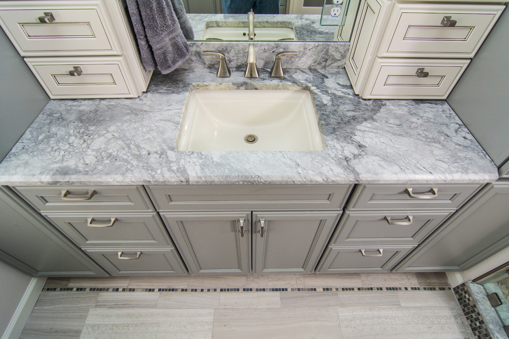 Bathroom - mid-sized contemporary gray tile ceramic floor bathroom idea in DC Metro with an undermount sink, gray cabinets, quartzite countertops and gray walls