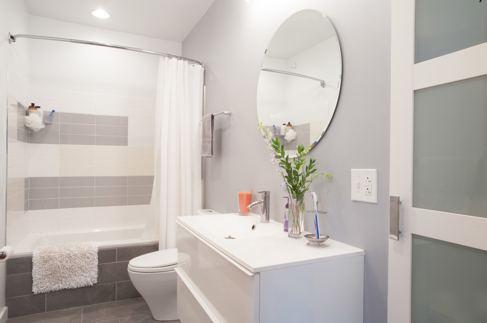 Bathroom - contemporary bathroom idea in Other with an integrated sink