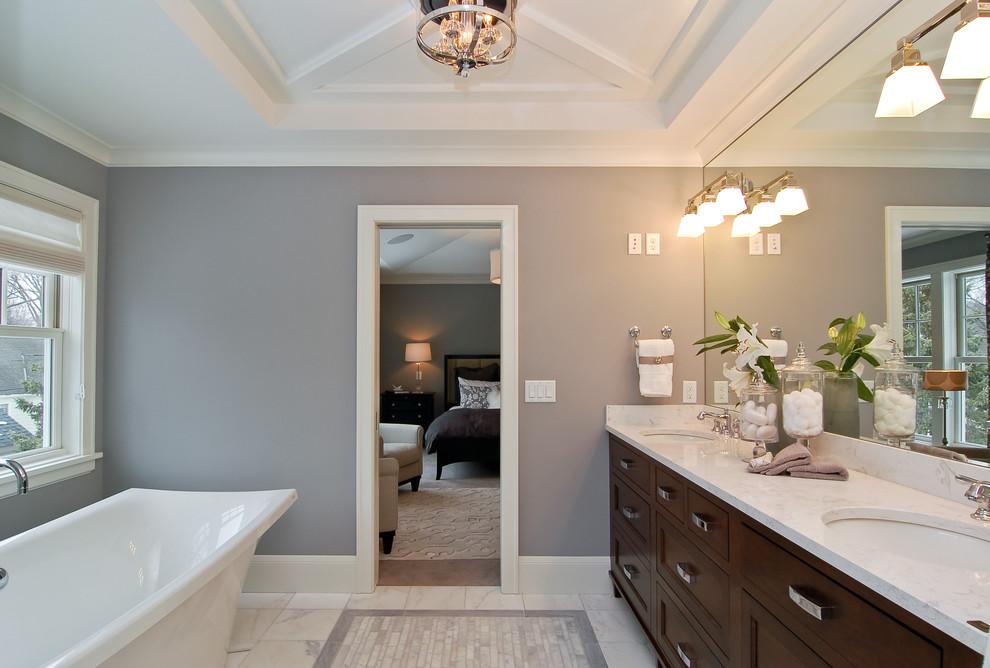 Freestanding bathtub - transitional freestanding bathtub idea in Minneapolis with marble countertops