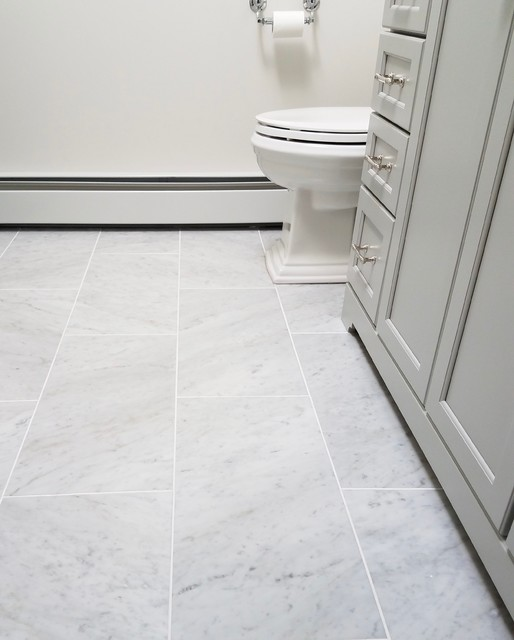 Example of a mid-sized transitional 3/4 gray tile and subway tile marble floor and gray floor alcove shower design in Bridgeport with recessed-panel cabinets, gray cabinets, a one-piece toilet, white walls, an undermount sink, marble countertops and a hinged shower door