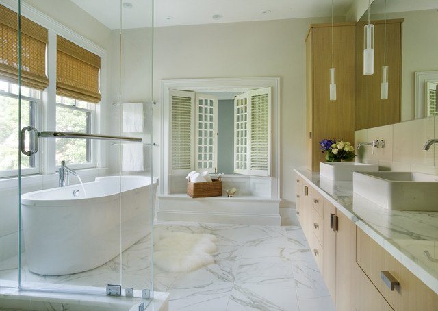 Example Of A Trendy Marble Floor And Gray Floor Freestanding Bathtub Design  In Boston With A
