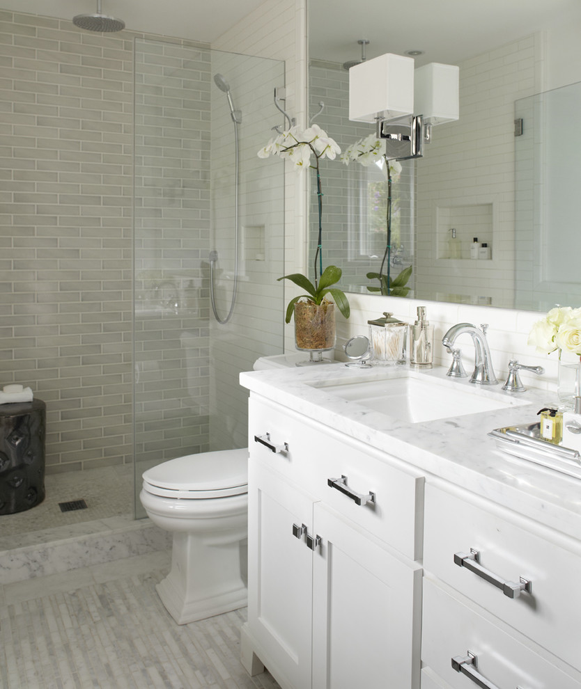 Example of a transitional subway tile bathroom design in San Francisco with marble countertops and white countertops