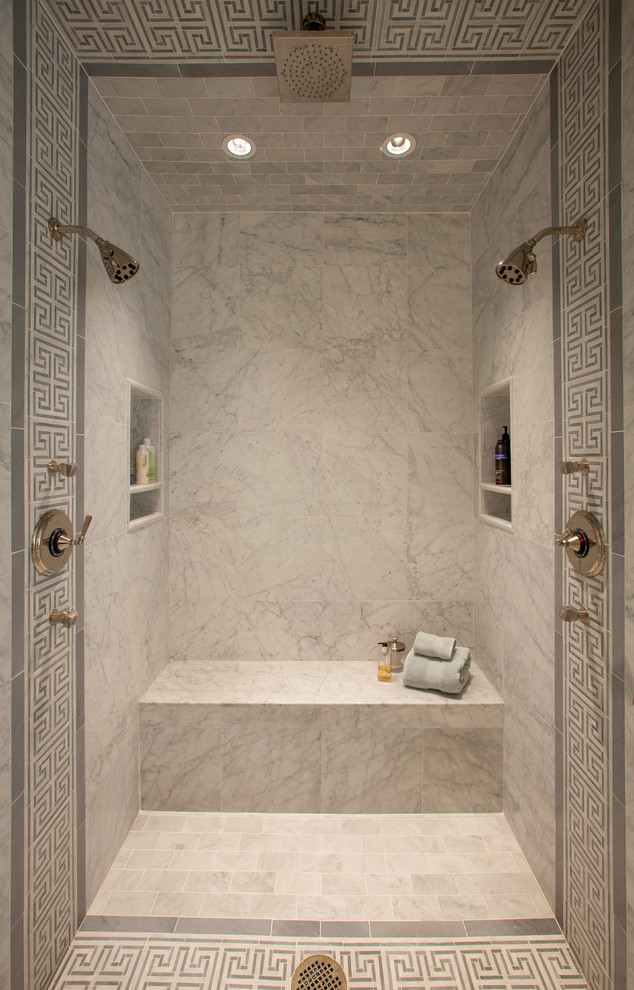 Example of a classic gray tile alcove shower design in Dallas with marble countertops