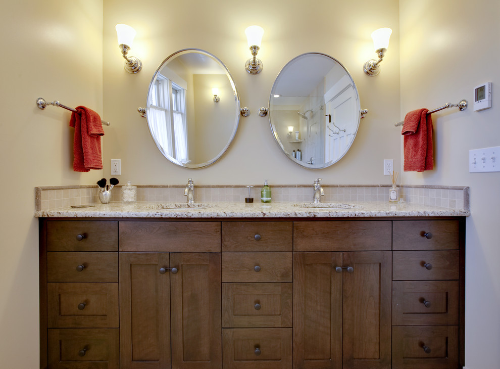 Example of an arts and crafts bathroom design in Seattle with granite countertops