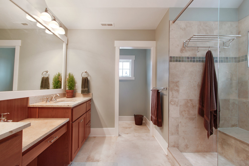 Inspiration for a mid-sized craftsman master beige tile and porcelain tile porcelain tile and beige floor bathroom remodel in Seattle with shaker cabinets, medium tone wood cabinets, gray walls, an undermount sink, quartzite countertops and beige countertops