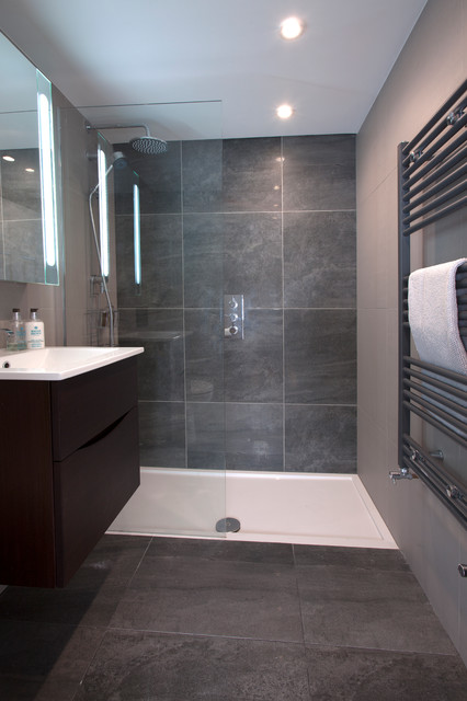 Small contemporary shower room in London with flat-panel cabinets, grey cabinets, a walk-in shower, grey tiles, ceramic tiles and a built-in sink.