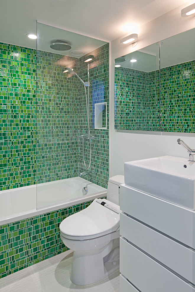 Inspiration for an eclectic mosaic tile and green tile bathroom remodel in New York with a vessel sink