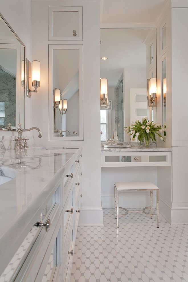 Inspiration for a large timeless master white tile and glass tile ceramic tile and white floor bathroom remodel in New York with marble countertops, furniture-like cabinets, white cabinets, white walls, an undermount sink and white countertops