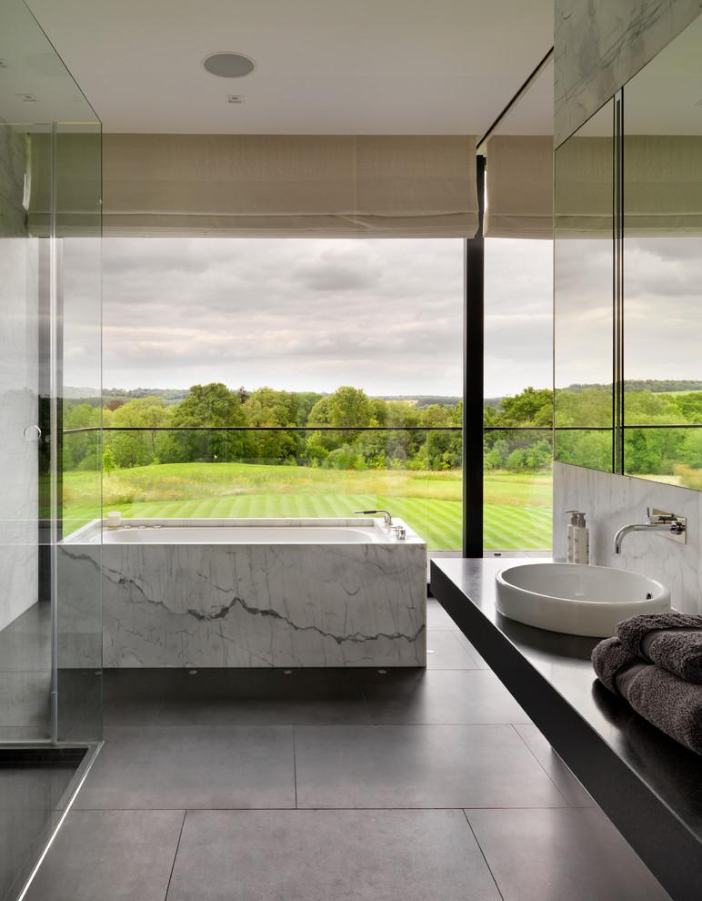 Trendy freestanding bathtub photo in London