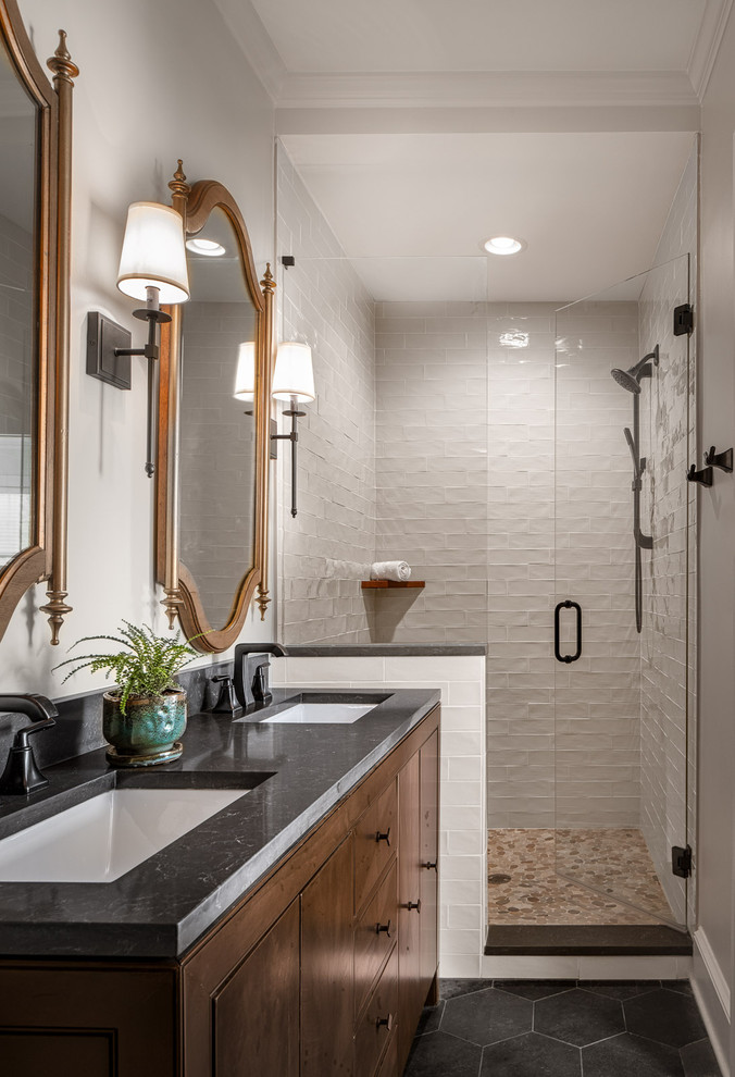 Example of a large transitional master white tile and subway tile ceramic tile and gray floor wet room design in Atlanta with furniture-like cabinets, dark wood cabinets, a one-piece toilet, beige walls, an undermount sink, quartz countertops, a hinged shower door and gray countertops