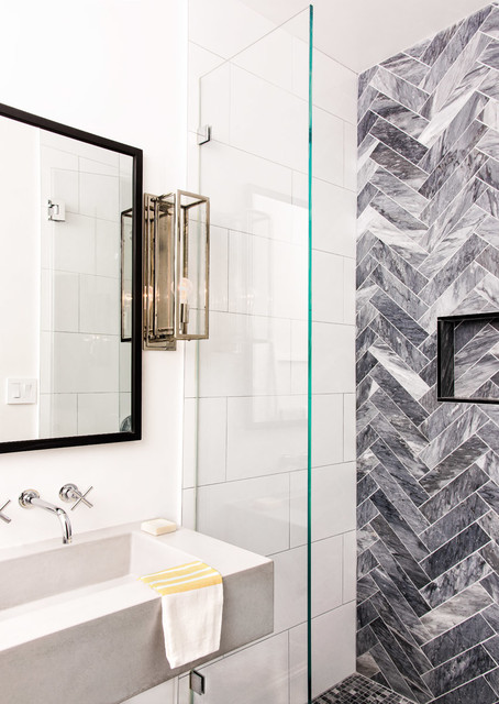 Trendy 3/4 gray tile and white tile open shower photo in DC Metro with an integrated sink
