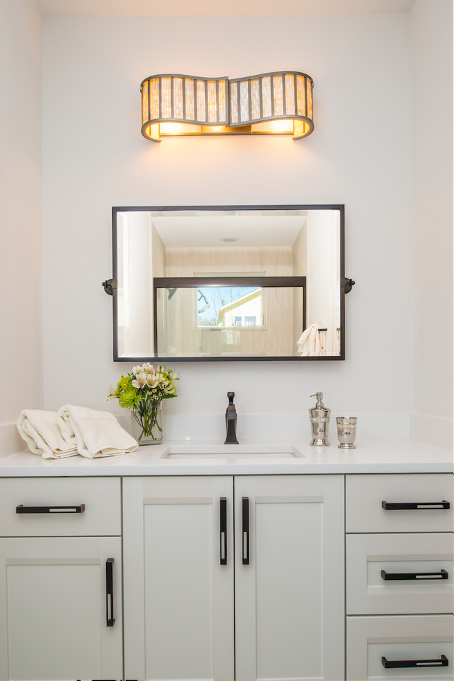 Example of a farmhouse beige tile bathroom design in Austin with shaker cabinets, white cabinets, gray walls, an undermount sink and quartz countertops