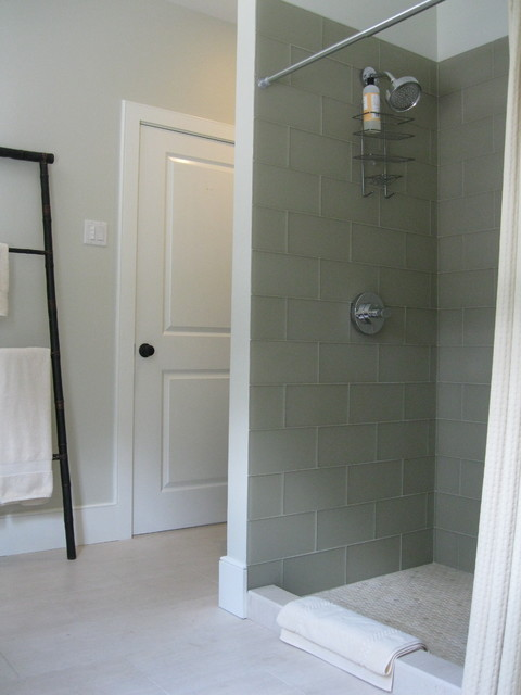 Guest bathroom with glass tile, marble penny tile and Relvinha limestone floor asian bathroom