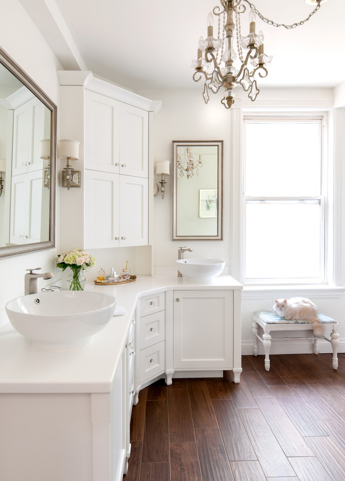 Inspiration for a transitional bathroom remodel in Toronto with solid surface countertops and a vessel sink