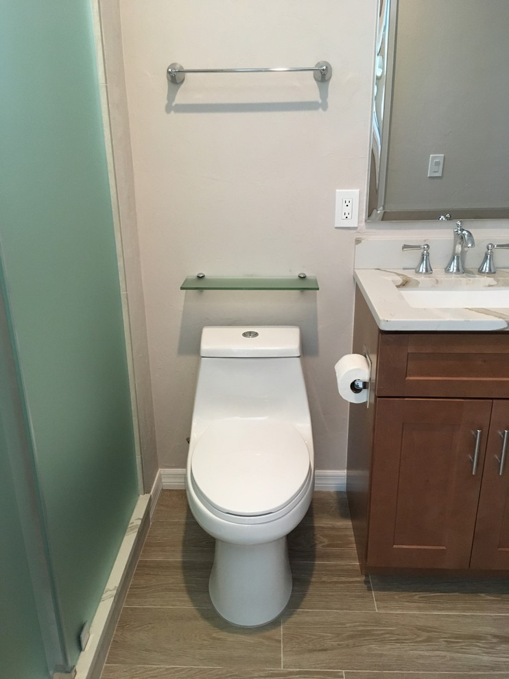 Inspiration for a mid-sized timeless master white tile and porcelain tile porcelain floor and multicolored floor bathroom remodel in Jacksonville with shaker cabinets, medium tone wood cabinets, white walls, an undermount sink, quartzite countertops and white countertops