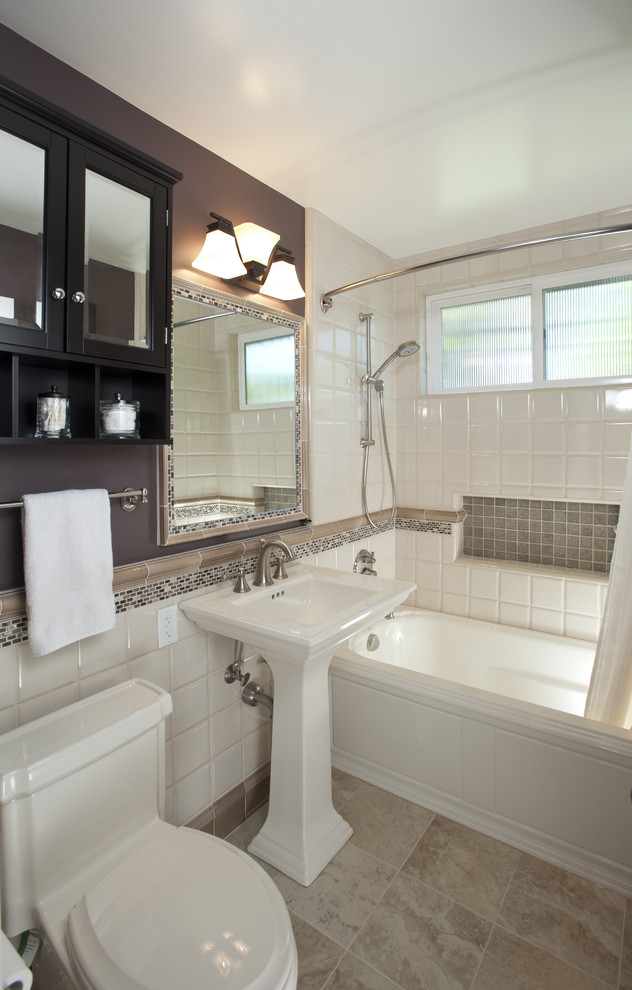 Inspiration for a mid-sized timeless 3/4 ceramic tile and white tile travertine floor and beige floor bathroom remodel in San Francisco with a pedestal sink, shaker cabinets, black cabinets, a one-piece toilet and purple walls