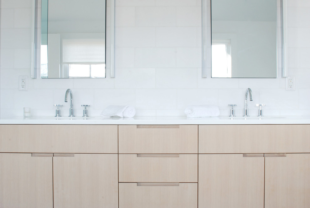 Inspiration for a contemporary white tile and stone tile bathroom remodel in New York with furniture-like cabinets, light wood cabinets and quartz countertops