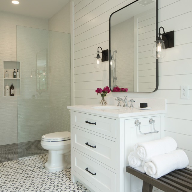 Coastal shower room in Minneapolis with engineered stone worktops, recessed-panel cabinets, white cabinets, a built-in shower, white tiles, white walls, a submerged sink, white floors and an open shower.
