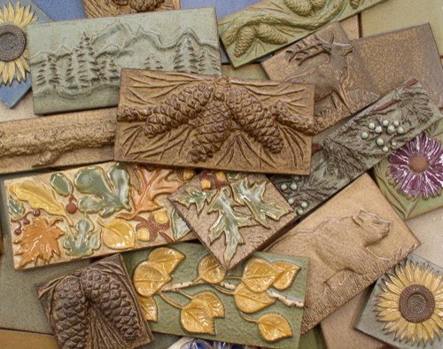 Handmade ceramic tiles animal pinecone flower and leaf motifs by