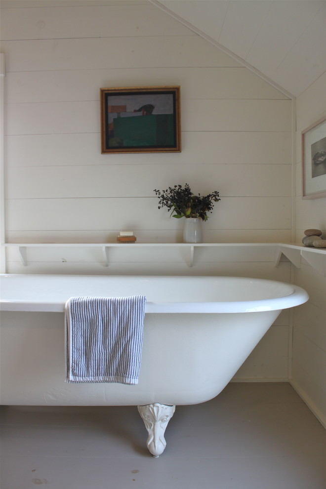 Inspiration for a rustic claw-foot bathtub remodel in Portland Maine
