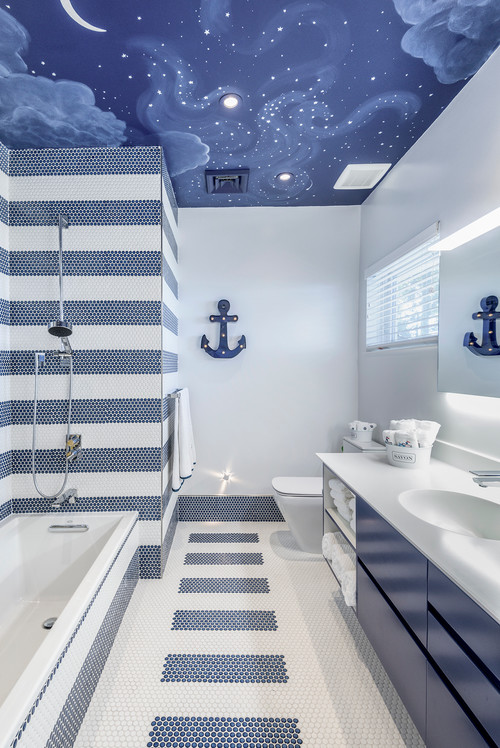 A classic blue-and-white nautical theme and a surprise ceiling create a fun atmosphere for siblings